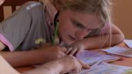 CU Girl doing maths school work at home / San Pedro de Atacama, Norte Grande, Chile