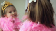 CU R/F Girl (4-5) dressed up as princess looking in mirror / Jersey City, New Jersey, USA