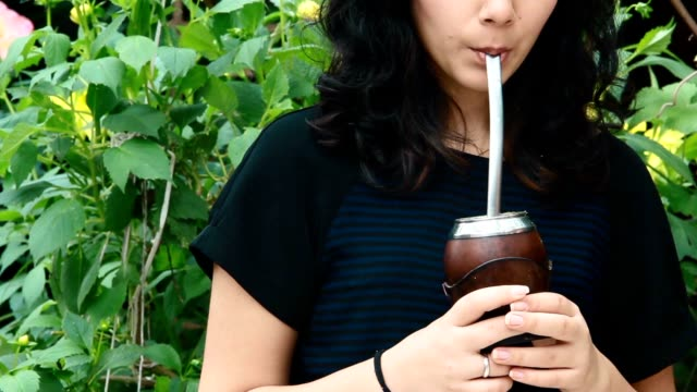 girl drinking mate tea.