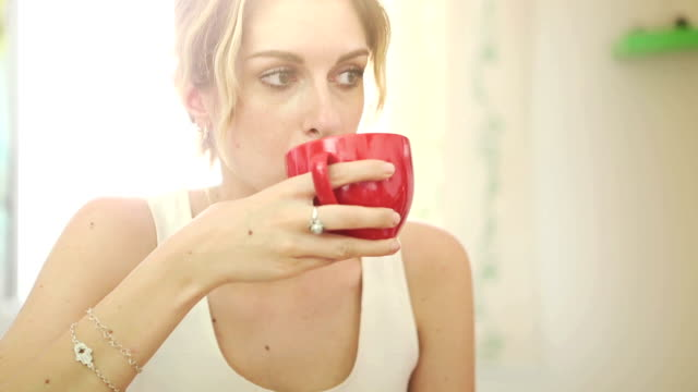 Girl drinking tea in a cup