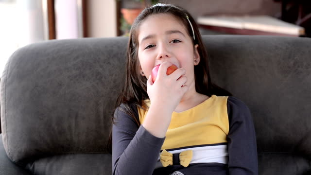 Girl eating apple.