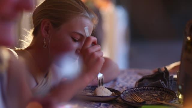 girl eating at table