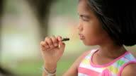 Girl eating bugs food