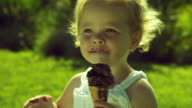 CU Girl (2-3) eating chocolate ice cream cone / Burbank, California, USA