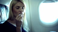 Girl eating in airplane