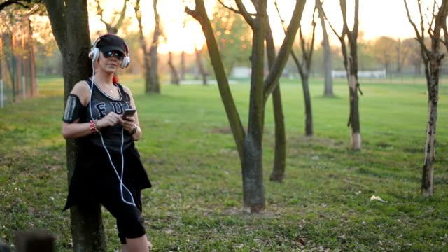 Girl enjoying music in the park