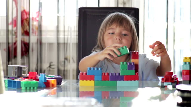 Girl Exploring Block Toys