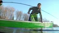 WS LA Girl (14-15) falling off canoe into river, New London, Wisconsin, USA