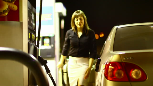 Girl filling up a car
