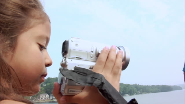 Girl filming with digital camcorder / New Jersey