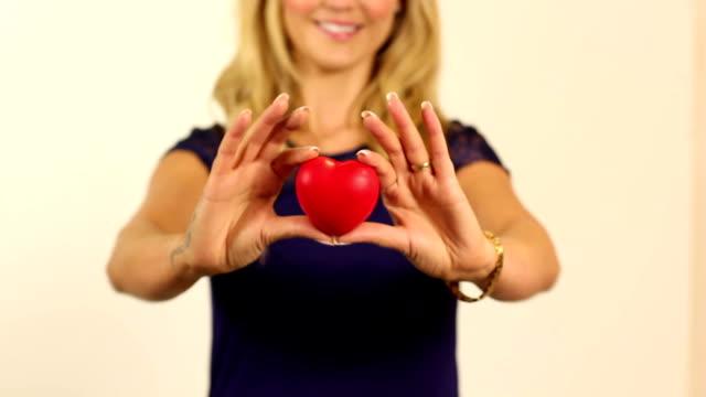 Girl giving her heart / love