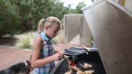 girl grilling chicken