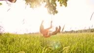 SLO MO Girl having fun swinging on a tree swing