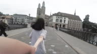 SLO Girl holding hands with boy and runing on Zurich, Switzerland