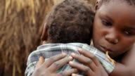 CU Girl holding her small sister / Lukuzi, Eastern, Zambia