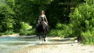 HD SLOW-MOTION: Girl horseriding and lose her hat