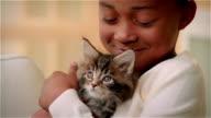 ECU, Girl (6-7) hugging Maine Coon kitten