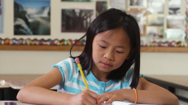 CU Girl (10-11) in classroom, raising hand, Manchester, Vermont, USA