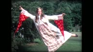 1968 girl in flowing robe doing dance pose