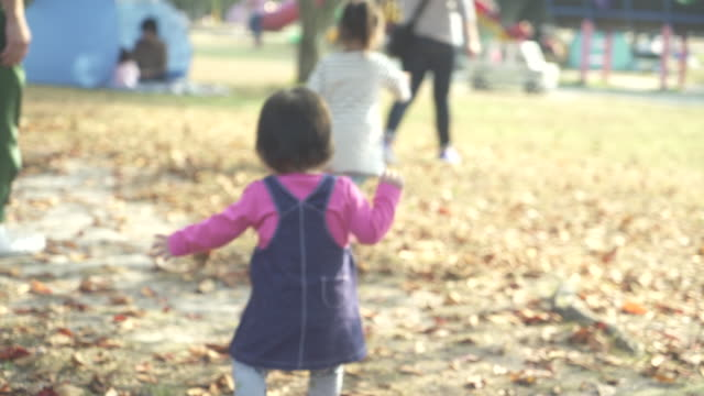 Girl is walking in the park with family