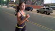 MS POV Girl jogging with ipod and earphone on street /New York, New York, United States