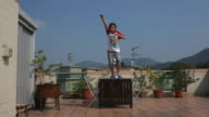Girl jumping in ultra slow motion