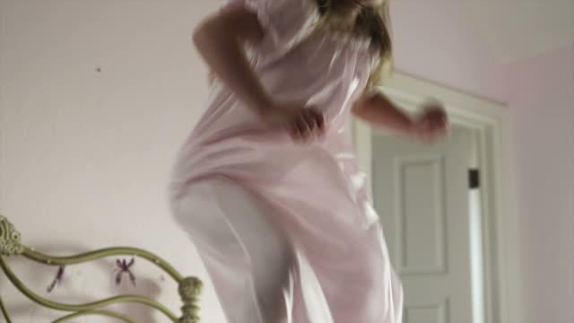 MS Girl (2-3) jumping on bed, American Fork, Utah, USA