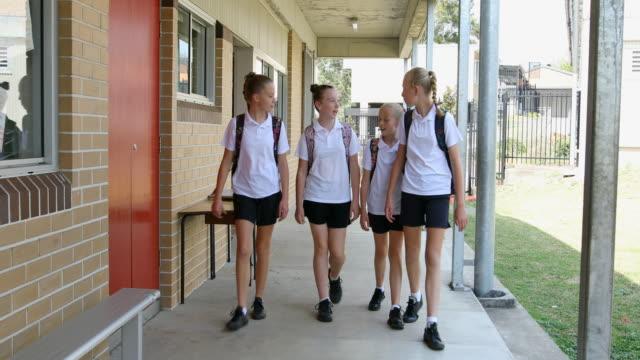 Girl Junior High School Students Arriving at School
