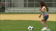 WS Girl kicking soccer ball and dancing on baseball diamond/ Fanwood, New Jersey