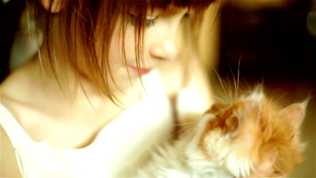 Girl Kissing Cat