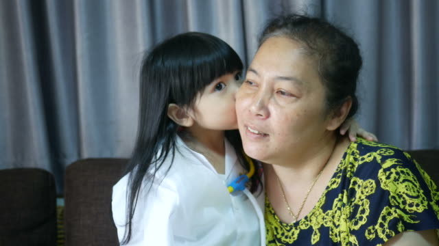 girl kissing her grandmother