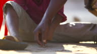 Girl learns to write in sand pull focus