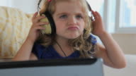 CU Girl (4-5) listening music with large headphones / Jersey City, New Jersey, USA