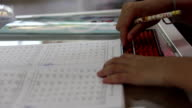 girl made homework calculate mathematics by use abacus