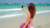 Girl make selfie on beach,Slow motion