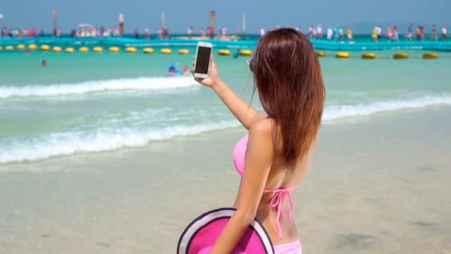 Girl make selfie on beach,Slow motion