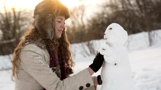 Girl making a snowman
