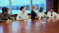 MS ZI Girl managing group of businesspeople during meeting in board room / Rye Brook, New York, USA