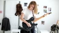 Girl musician playing guitar