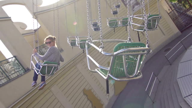 Girl on chairoplane in an amusement park