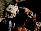 1950 girl on horse, cowboy in sling