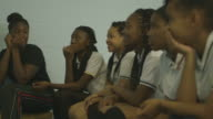Girl players hand raised while answering
