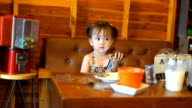 Girl playing cell phone in restaurant