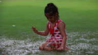Girl playing in mud in the rainy season