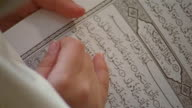 CU, Girl reading book on religion school, close-up of open book, Cairo, Egypt