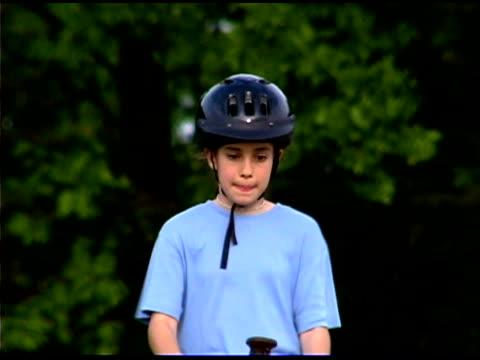 Girl riding horseback at ranch