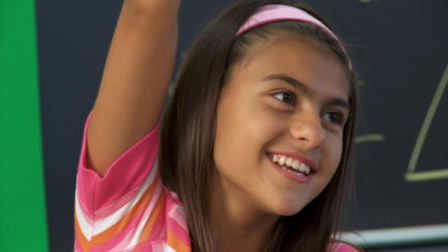 CU, TU, Girl (10-11) rising hand and talking in classroom, Richmond, Virginia, USA