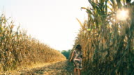 HD DOLLY SLOW MOTION: Girl Running Along Corn Field