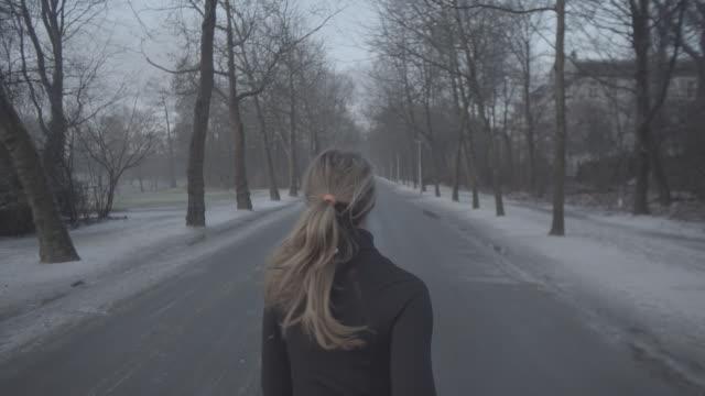 M/S SLOMO STEADY girl running in a park, back