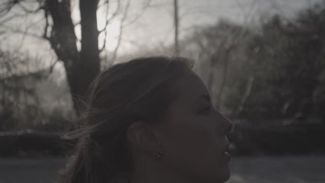 C/U SLOMO STEADY girl running in a park, profile